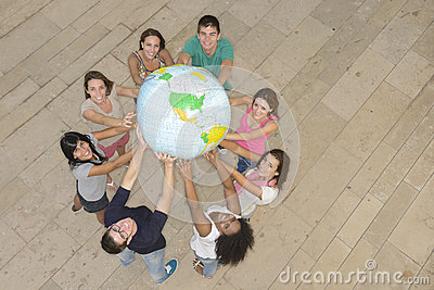 Group of people holding  the Earth Globe