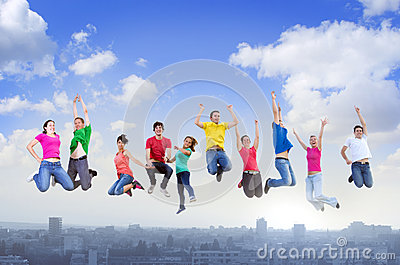 Group of people jumping above the city