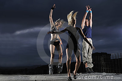 Group of people jumping in air