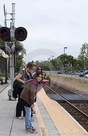 Group of People Looking for Train Arrival