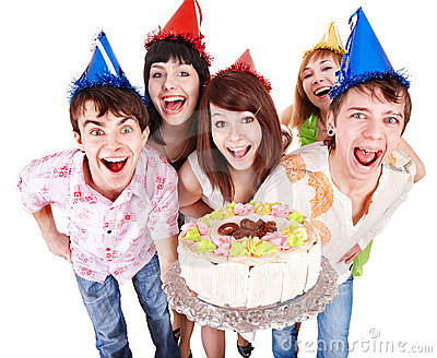 Group of people in party hat with cake.