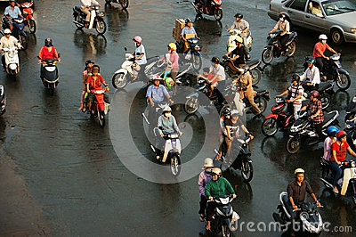 Group of people ride motorbike in rush hour Editorial Stock Image