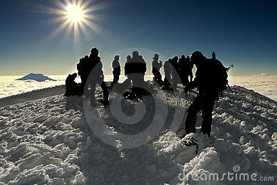Group of people on the summit of a high mountain