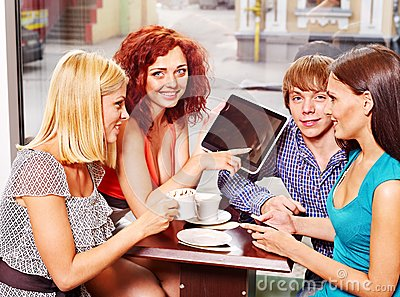 Group people with tablet computer at cafe