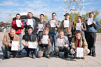 Group of photographers with sheets of  paper