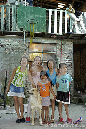 Group portrait of children with pet, Argentina