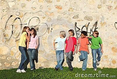 Group of pre teens whispering
