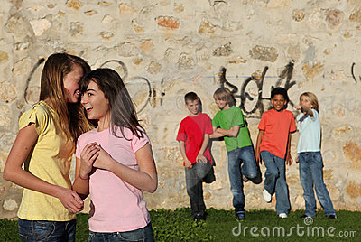 Group of pre teens whispering