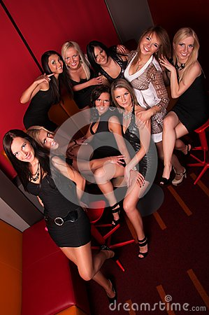 Group of pretty girls in night club