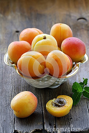 Group ripe juicy fruit apricot on a wooden table