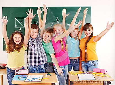 Group of school child  in classroom.