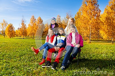Group of school kids in autumn park