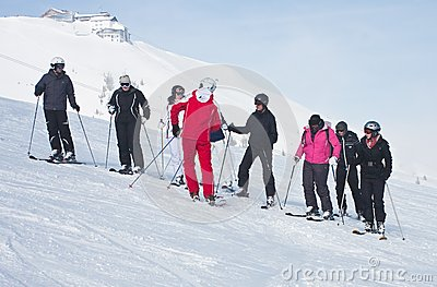 The group of skiers and instructor Editorial Image