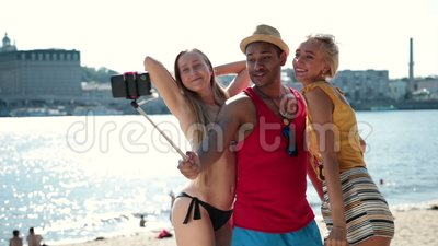 Group of smiling friends making selfie on beach stock video