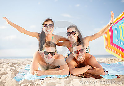 Group of smiling people having fun on the beach