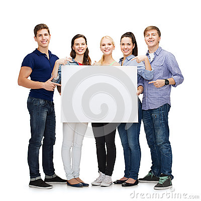 Group of smiling students with white blank board