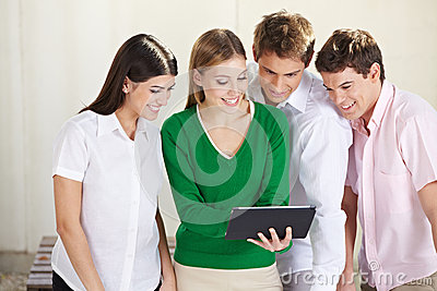 Group of students looking at tablet