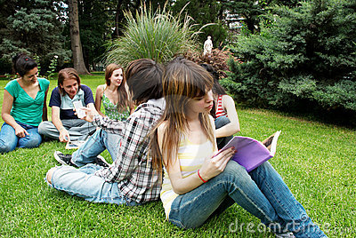 Group of students sitting in park