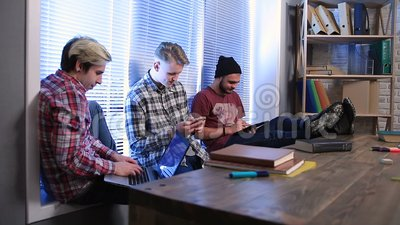 Group of students studying using digital devices stock video