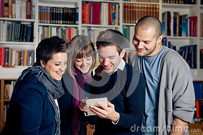 Group of students using tablet computer