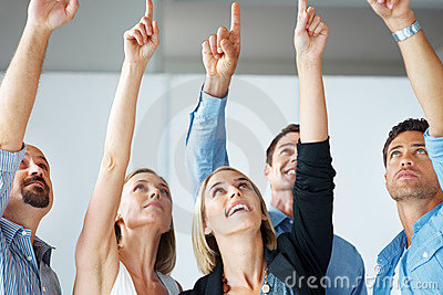 Group of successful business people pointing up