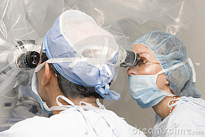 Group Of Surgeons Operating