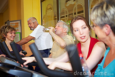 Group taking spinning class in gym