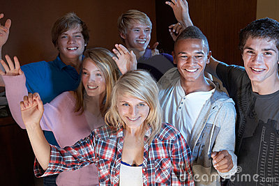 Group Of Teenage Friends Dancing And Drinking