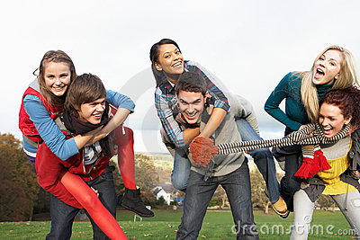 Group Of Teenage Friends Having Piggyback Rides
