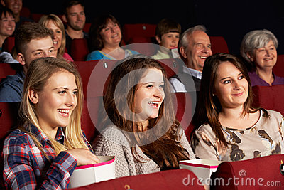 Group Of Teenage Girls Watching Film In Cinema Royalty Free Stock Images - Image: 26246589