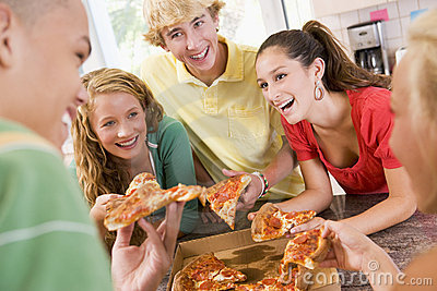 Group Of Teenagers Eating Pizza