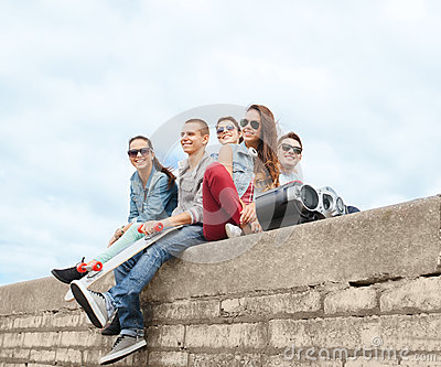 Group of teenagers hanging outside