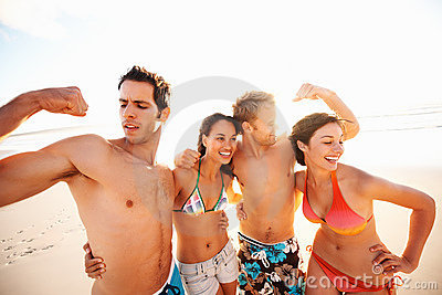Group of teens at the beach in a playful mood