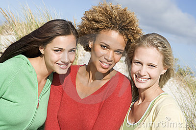 Group of three female friends at beach