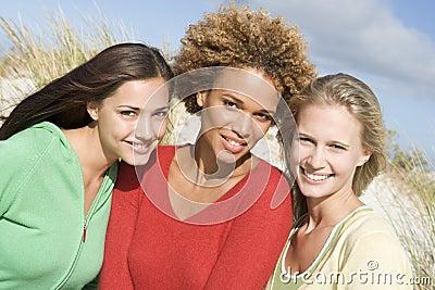 Group of three female friends at beach