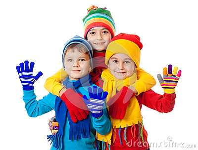 Group of three kids in winter clothes