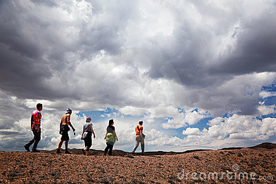 Group of tourists in the desert