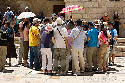 Group of tourists listening to the guide Editorial Stock Photo