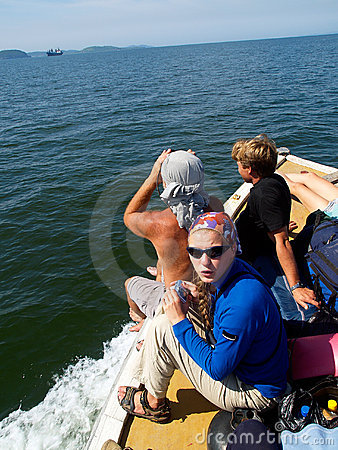 Group of tourists on motorboat