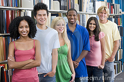 Group of university students in library