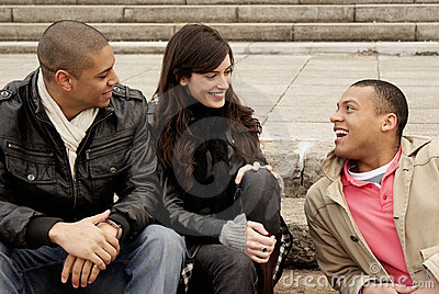 Group of university students sitting on steps
