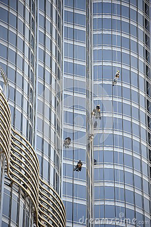 Group of workers cleaning windows Editorial Stock Photo