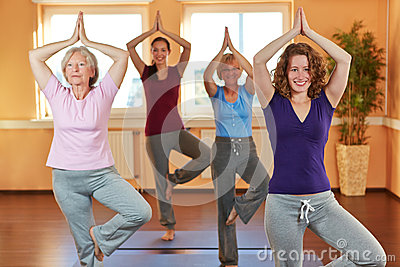 Group in yoga class in health club