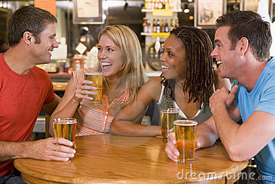 Group of young friends drinking and laughing