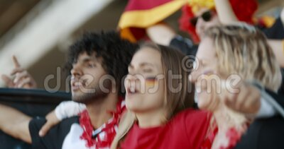 German soccer fan cheering their national team. Group of young man and woman cheering their national team. German football team supporters enjoying during stock video