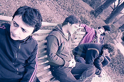 Group of young men on bench