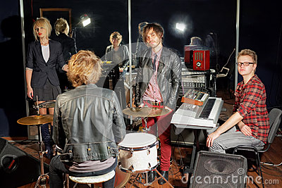 Group of young musicians in studio