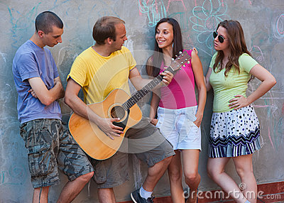 Group of young people with guitar