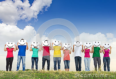 Group of young people holding papers with smileys