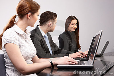 Group of young people in the office working togeth